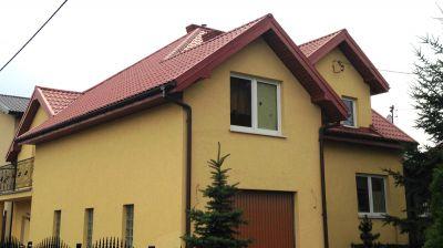 Kompleksowe pokrycie dachu blachodachówką rok.2004 Ząbki ul.Warszawska.